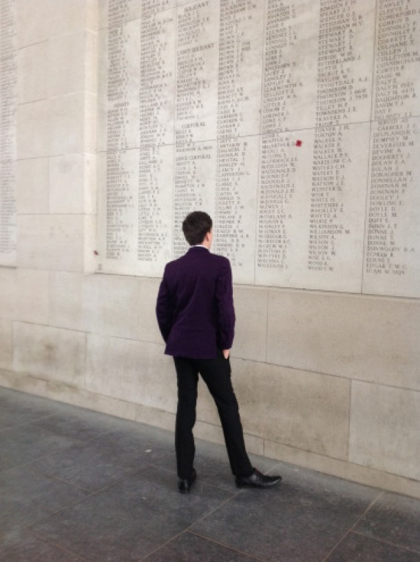 Image of School kid looking at list of fallen soldier's names