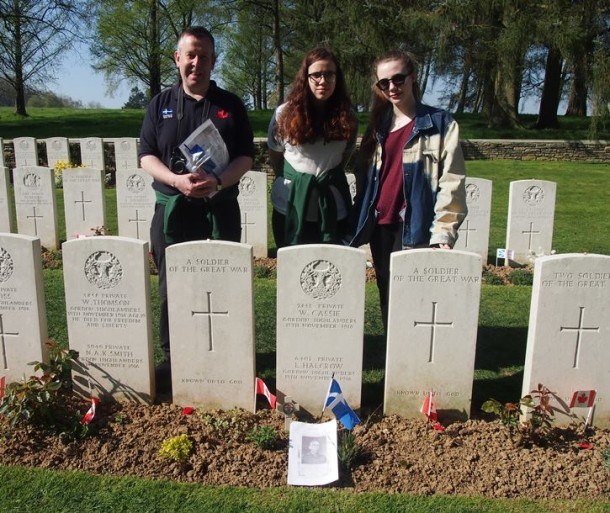 Holly Mouat and Carys Nield with history teacher John Sandison at Y Ridge Cemetery