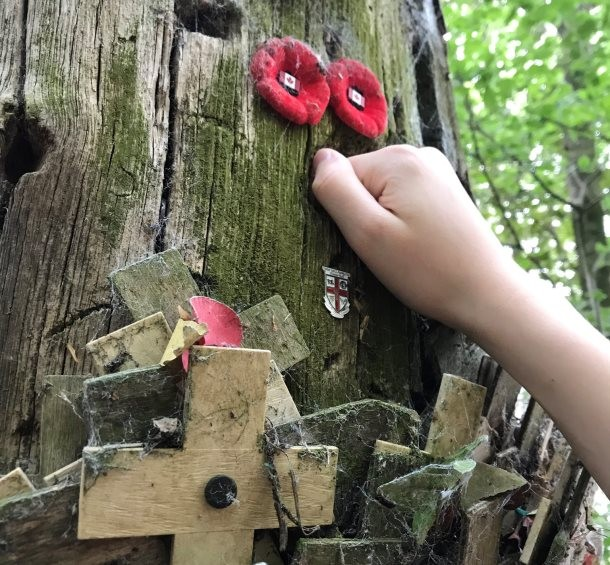 A student inspects the bullet holes at Sanctuary Wood Museum Hill 62 on a battlefields school trip